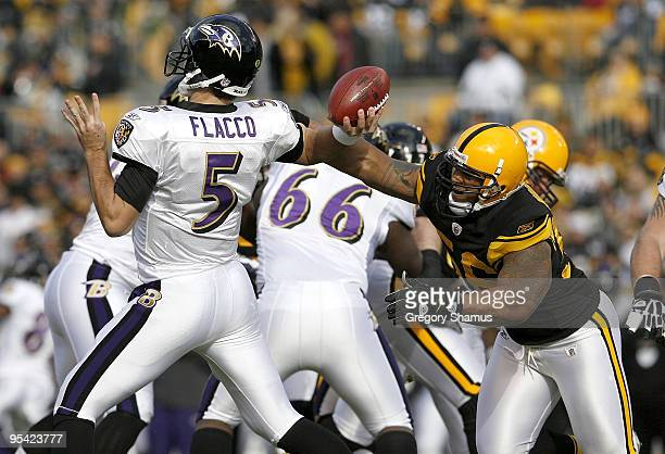 LaMarr Woodley of the Pittsburgh Steelers disrupts the throwing arm of Joe Flacco of the Baltimore Ravens on December 27 2009 at Heinz Field in...