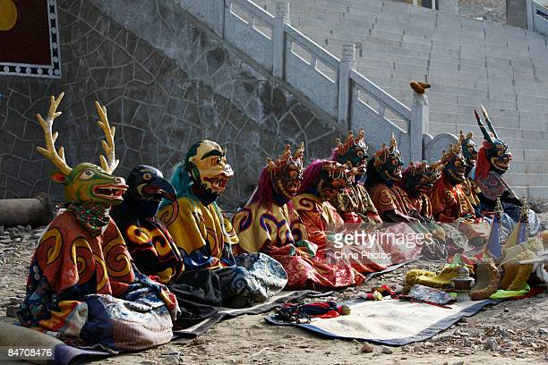 Lamas attend the 'Tiaoqian' praying ceremony at the Youning Temple on February 8 2009 in Huzhu County of Qinghai Province China The Youning Temple...
