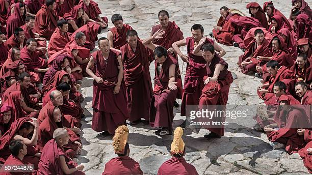 Lamas debate about the sutra of Buddhism at drepung temple on May 14, 2014 in Lhasa, Tibet, China.