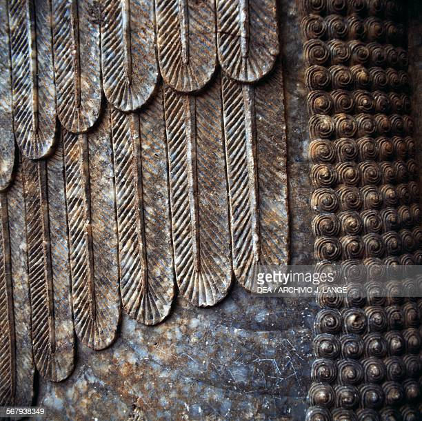 Lamassu colossal statue of a winged bull with a human face detail of the wings Nineveh site was partially destroyed in 2015 Iraq Assyrian...
