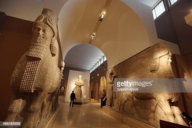 Lamassu statues an Assyrian deity often depicted as a wingedbull with a human head are displayed in the Assyrian hall at Iraq's National Museum on...