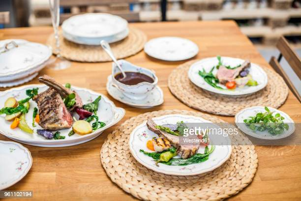 Lamb and vegetables on dining table