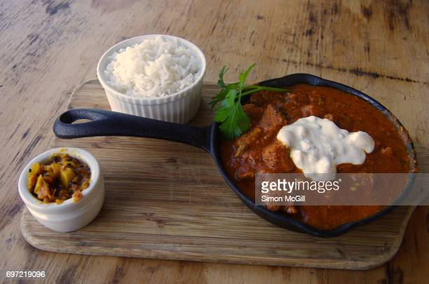 Lamb curry, boiled rice and vegetable pickle relish