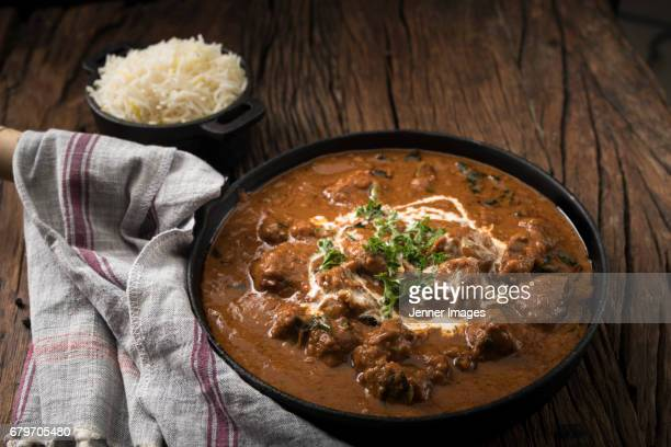 Lamb Curry Meal On Rustic Wooden Table.