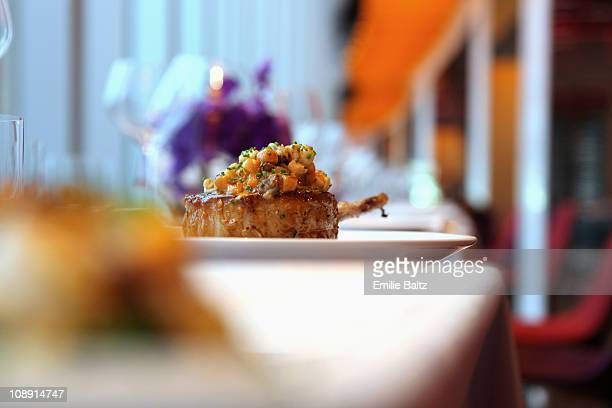 A lamb cutlet with carrot salsa on a plate