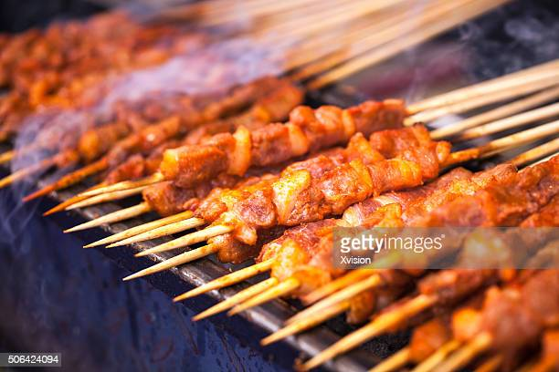 lamb in bamboo stick barbecued on fire - fuzhou stock pictures, royalty-free photos & images