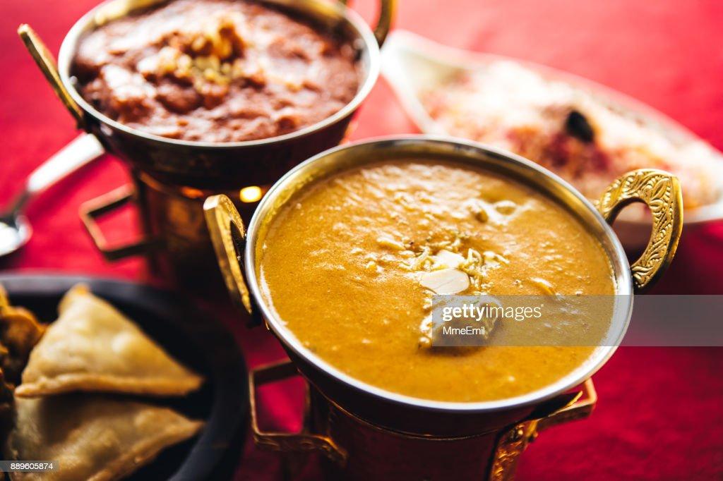 Lamb korma curry inside Karahi Indian Serving Dishes. North Indian food