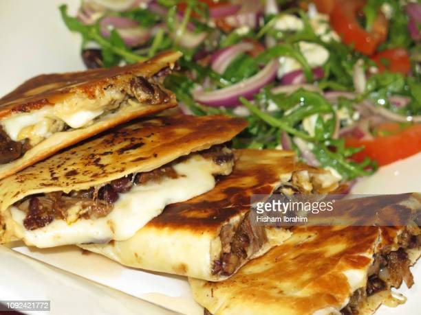 lamb quesadillas and salad - food state stock pictures, royalty-free photos & images