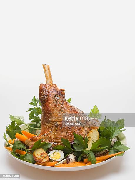 lamb shank with quails' eggs, carrots and parsley for easter - osterlamm stock-fotos und bilder