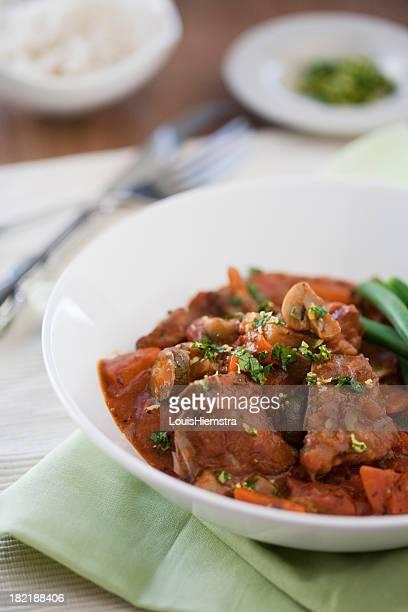 Lamb stew served on rustic dinnerware set