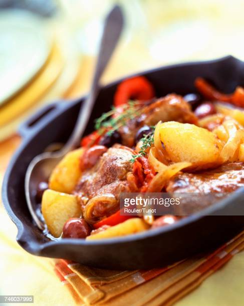 lamb tajine with olives, peppers and potatoes - olive pimento stock photos and pictures