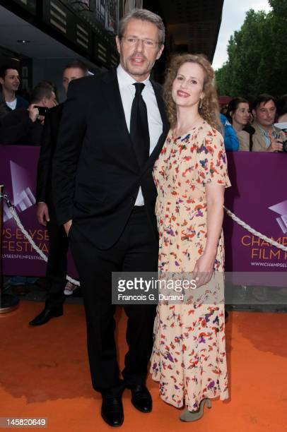 Lambert Wilson and Florence Darel arrive to the ChampsElysees Film Festival at Cinema Gaumont Marignan on June 6 2012 in Paris France