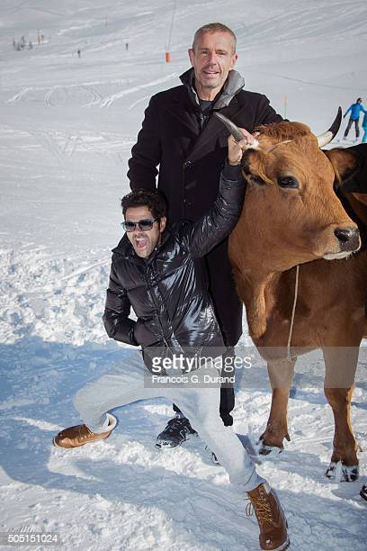 Lambert Wilson and Jamel Debbouze pose with a cow during the photocall for 'La Vache' during the 18th L'Alpe D'Huez International Comedy Film...