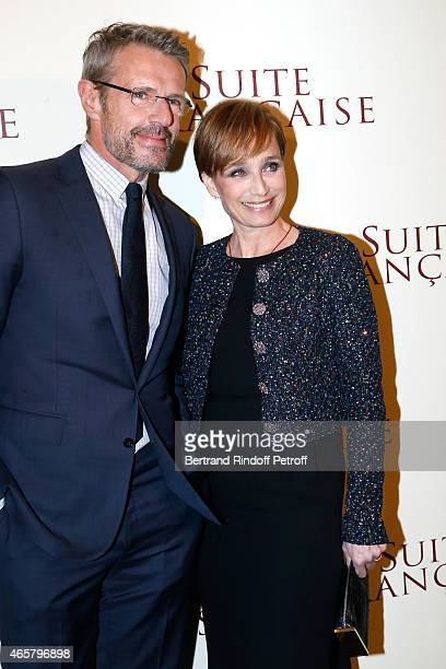 Lambert Wilson and Kristin Scott Thomas attend the world premiere of 'Suite Francaise' at Cinema UGC Normandie on March 10 2015 in Paris France