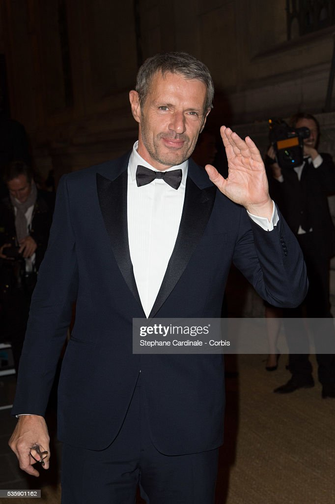 Lambert Wilson arrives at a Ralph Lauren Collection Show and private dinner at Les Beaux-Arts de Paris on October 8, 2013 in Paris, France. On this occasion Ralph Lauren celebrates the restoration project and patron sponsorship of 'L'Ecole des Beaux-Arts'.