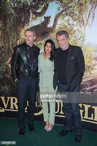 Lambert Wilson Leila Bekhti Eddy Mitchell attend the The Jungle Book Paris Premiere at Cinema Pathe Beaugrenelle on April 11 2016 in Paris France