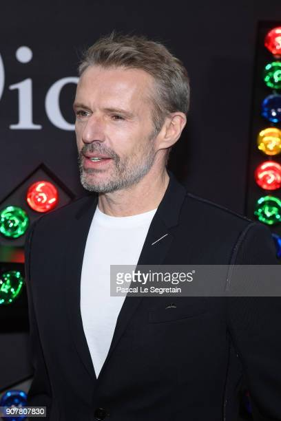 Lambert Wilson poses at Dior Homme Menswear Fall/Winter 20182019 show as part of Paris Fashion Week at Grand Palais on January 20 2018 in Paris France