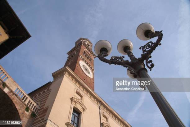 lamberti tower and lamp at the piazza delle erbe in verona, discovering italy - man made space stock pictures, royalty-free photos & images