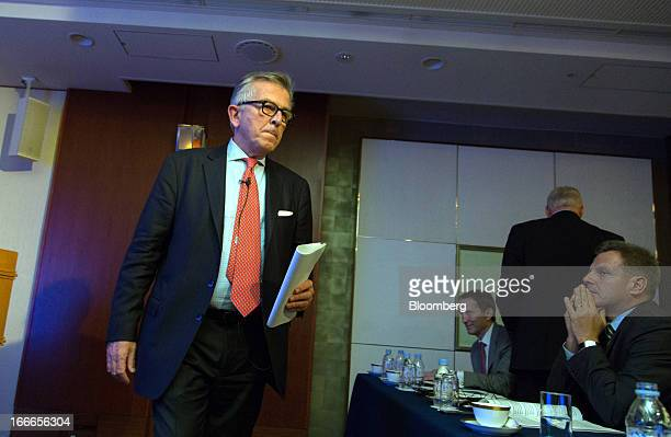 Lamberto Andreotti chief executive officer of BristolMyers Squibb Co left walks to his seat after speaking on the podium during a news conference in...
