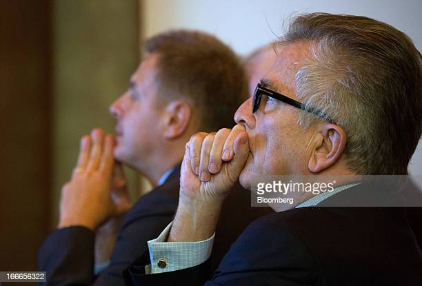 Lamberto Andreotti chief executive officer of BristolMyers Squibb Co right and Emmanuel Blin president and chief executive officer of BristolMyers...