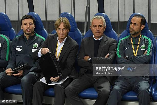 Lambertus Van Marwijk and Mark Van Bommel of Saudi Arabia look on prior to the 2018 FIFA World Cup Qualifier match between Japan and Saudi Arabia at...