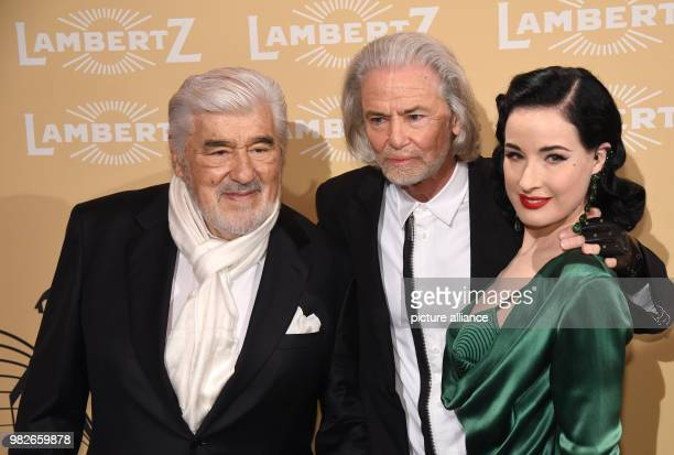 Lambertz manager Hermann Buehlbecker welcomes actor Mario Adorf and burlesque artist Dita Von Teese at the 'Lambertz Monday Night' event in Cologne...