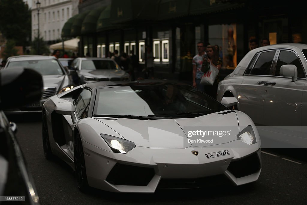 A Lamborghini Aventador drives through Knightsbridge on August 8, 2014 in London, England. Tourists and car enthusiasts have been flocking to the wealthy London district to see some of the world's most expensive and extravagant super cars. Many of the rich owners from Saudi Arabia and Kuwait come to London to escape the summer heat at home and to show off their cars before moving on to other European cities such as Paris and Cannes.