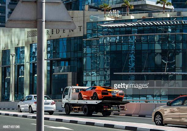 lamborghini evacuation - towing stock photos and pictures