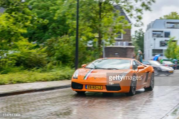 Lamborghini Gallardo driving in the rain