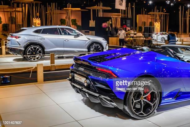 Lamborghini Huracan EVO Spyder convertible sports car and Lamborghini Urus luxury performance SUV car on display at Brussels Expo on January 8 2020...