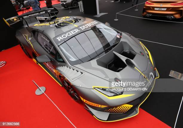 A Lamborghini Huracan Trofeo car is displayed at The International Automobile Festival in Paris on January 31 2018 / AFP PHOTO / JACQUES DEMARTHON