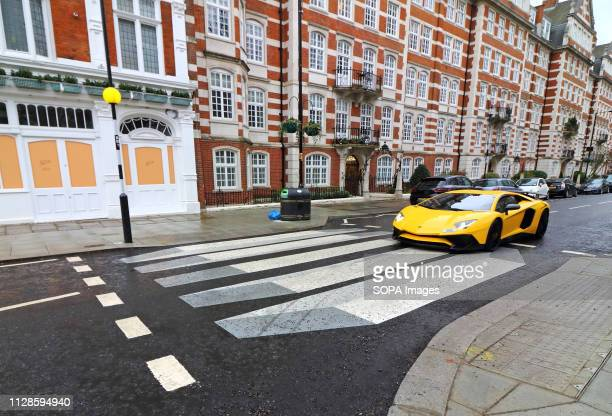 Lamborghini luxury car seen driving on the UK's first '3D' zebra crossing which has been painted on St John's Wood High Street as part of a 12-month...