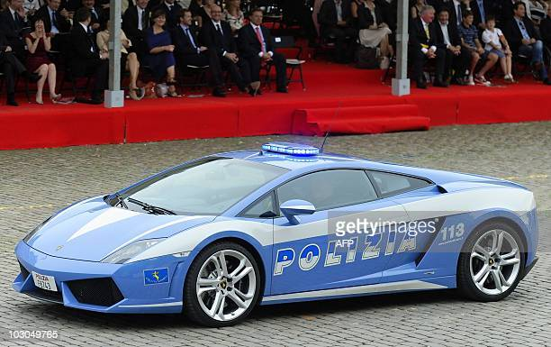 A Lamborghini police car takes part in the military parade in Brussels on July 21 as part of the Belgian National Day AFP PHOTO / BELGA PHOTO / ERIC...
