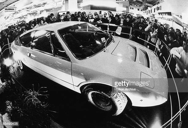 A Lamborghini Urraco sports car on display at a motor show circa 1972 Designed by Marcello Gandini of the Bertone design studio the fourseater was...