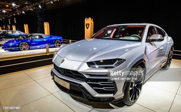 Lamborghini Urus luxury performance SUV car and Lamborghini Huracan EVO Spyder convertible sports car on display at Brussels Expo on January 8, 2020...