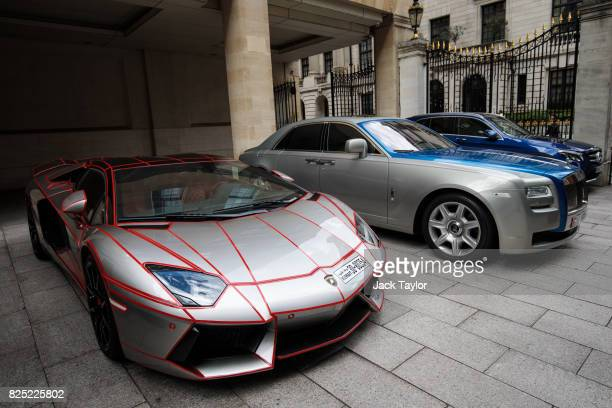 Lamborghini with a Kuwaiti licence plate and a Rolls Royce with a United Arab Emirates licence plate sit parked outside the Grosvenor House Hotel in...