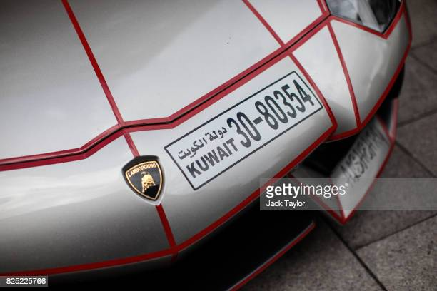 Lamborghini with a Kuwaiti licence plate sits parked outside the Grosvenor House Hotel in Mayfair on August 1 2017 in London England Each summer...