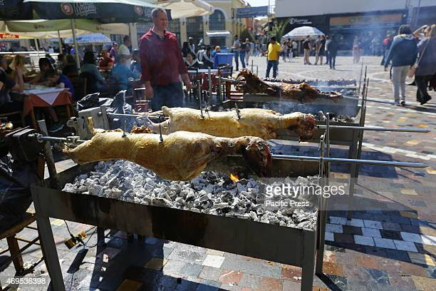 SQUARE ATHENS ATTICA GREECE Lambs are barbecued on a spit in Monastiraki Square in Athens Greeks and tourists celebrate the Orthodox Easter Sunday...