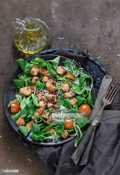 Lambs leaf lettuce with chicken, cherry tomatoes and Parmesan cheese