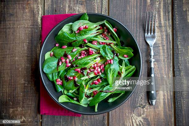 Lambs lettuce and pomegranate seeds in bowl