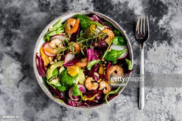 Lamb's lettuce, radicchio, shrimp, red radish, orange, pine nut, rosemary, avocado in bowl