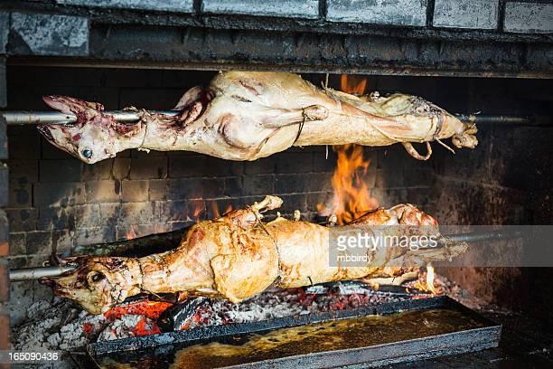 Lambs roasting on rotating spit