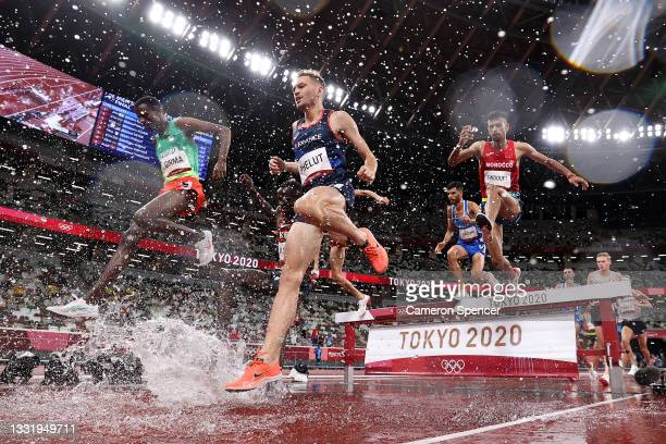 Lamecha Girma of Team Ethiopia, Alexis Phelut of Team France and Mohamed Tindouft of Team Morocco compete in the Men's 3000 metres Steeplechase Final...
