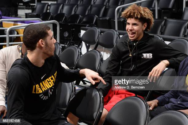 LaMelo Ball and Lonzo Ball of the Los Angeles Lakers talk in the stands before the game against the Golden State Warriors on November 29 2017 at...