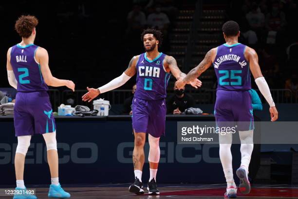 LaMelo Ball, Miles Bridges, and P.J. Washington of the Charlotte Hornets hi-five during the game against the Washington Wizards on May 16, 2021 at...
