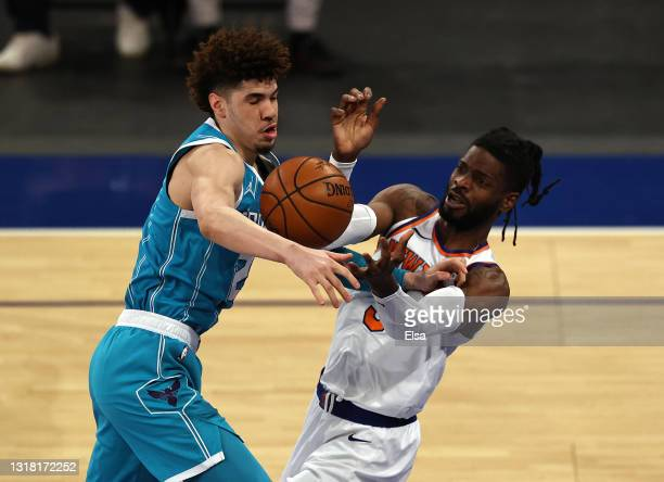 LaMelo Ball of the Charlotte Hornets and Nerlens Noel of the New York Knicks fight for the ball in the first quarter at Madison Square Garden on May...