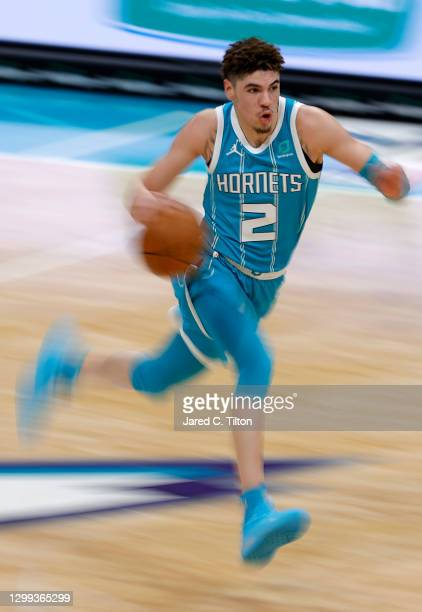 LaMelo Ball of the Charlotte Hornets brings the ball up court during the third quarter of their game against the Indiana Pacers at Spectrum Center on...