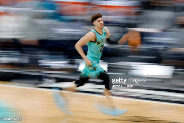 LaMelo Ball of the Charlotte Hornets brings the ball up court during the third quarter of their game against the Golden State Warriors at Spectrum...