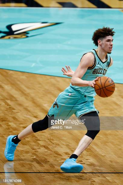 LaMelo Ball of the Charlotte Hornets brings the ball up court during the third quarter of their game against the LA Clippers at Spectrum Center on...