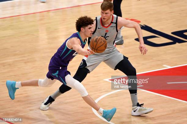 LaMelo Ball of the Charlotte Hornets dribbles in front of Davis Bertans of the Washington Wizards during the first half at Capital One Arena on May...